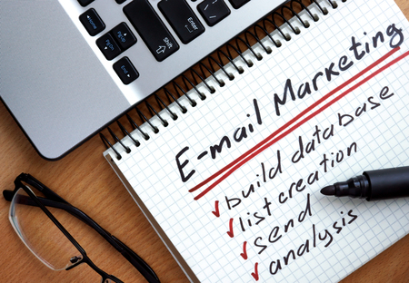 emails: Notepad with words email marketing. Stock Photo