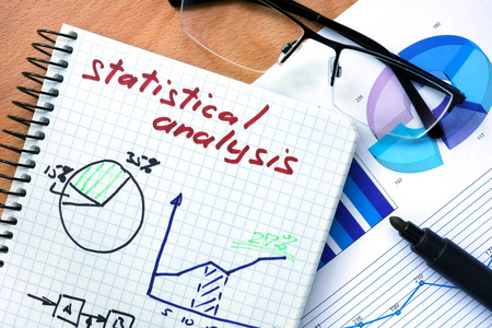 statistical: Notepad with words statistical analysis.