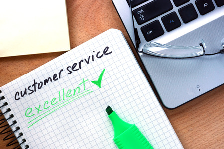 client service: Notepad with words customer service.