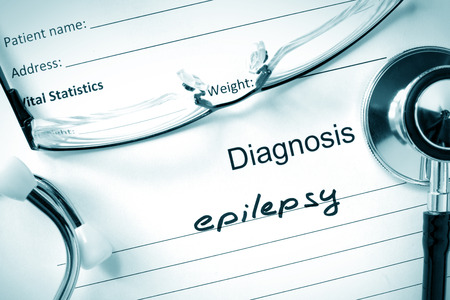 epilepsy: Diagnostic form with diagnosis Epilepsy and pills. Stock Photo