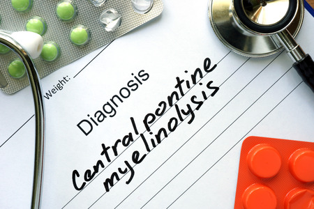 pontine: Diagnostic form with diagnosis Central pontine myelinolysis and pills. Stock Photo