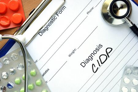 inflammatory: Diagnostic form with diagnosis Chronic inflammatory demyelinating polyneuropathy CIDP and pills. Stock Photo