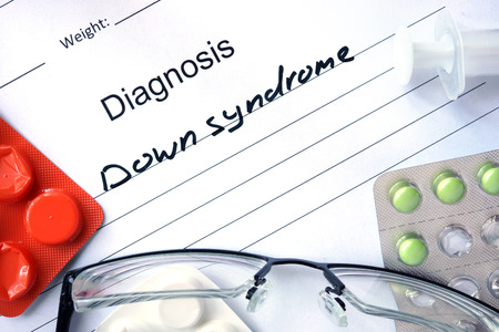 diagnosis: Diagnosis Down syndrome and tablets. Stock Photo