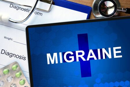 diagnostic: Diagnostic form with diagnosis Migraine and pills. Stock Photo