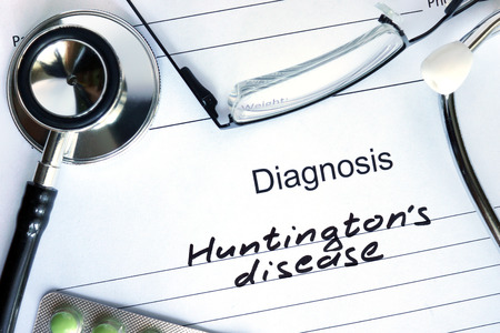 juveniles: Diagnostic form with diagnosis Huntingtons disease and pills.