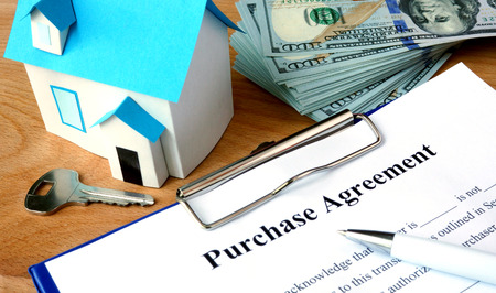 agreement: Purchase agreement document with dollars and home model.