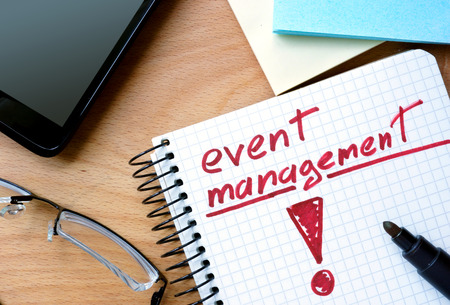 management process: Notepad with event management on office wooden table. Stock Photo