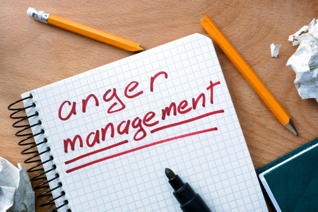 anger management: Notepad with anger management on office wooden table. Stock Photo