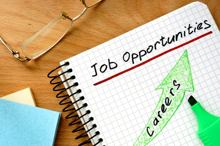 opportunity: Note with words job opportunities on a wooden background.