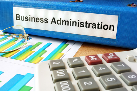 business administration: Folder with label business administration and charts.