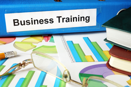 training business: Folder with label Business Training and charts.