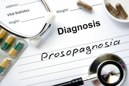 blindness: Diagnosis Prosopagnosia, pills and stethoscope.