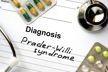 ailing: Diagnosis Prader-Willi syndrome, pills and stethoscope.