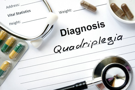 paraplegia: Diagnosis Quadriplegia, pills and stethoscope.