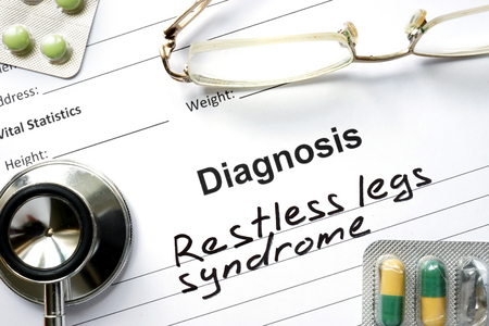 Diagnosis Restless legs syndrome, pills and stethoscope.