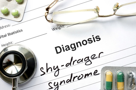 atrophy: Diagnosis shy-drager syndrome, pills and stethoscope.