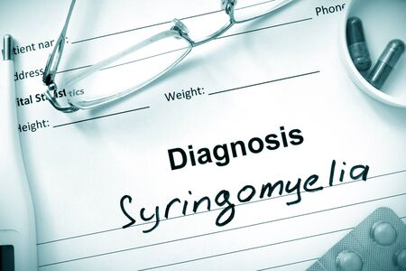 ailing: Diagnosis Syringomyelia, pills and stethoscope.
