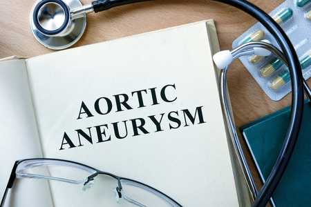 aortic: Aortic aneurysm concept. Book with stethoscope and pills.