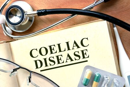coeliac: Coeliac disease concept. Book with stethoscope and pills. Stock Photo