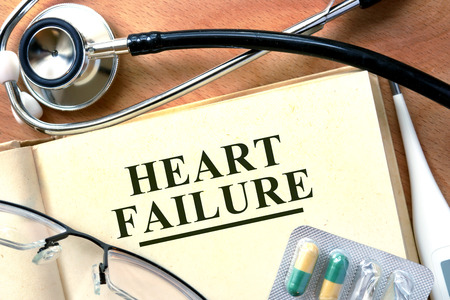 hf: Heart failure concept. Book with stethoscope and pills.