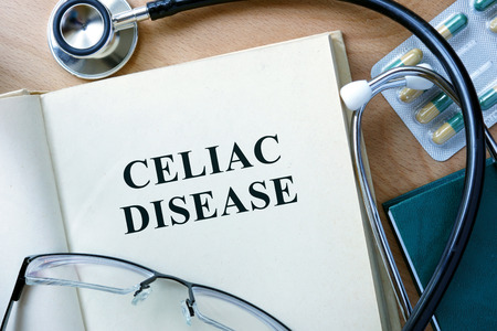 ailing: Celiac Disease concept. Book with stethoscope and pills.