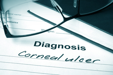 ocular diseases: Diagnosis list with Corneal ulcer and glasses. Stock Photo