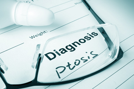 ocular diseases: Diagnosis list with Ptosis and glasses. Stock Photo