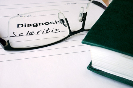 senile: Diagnosis list with Scleritis and glasses. Stock Photo