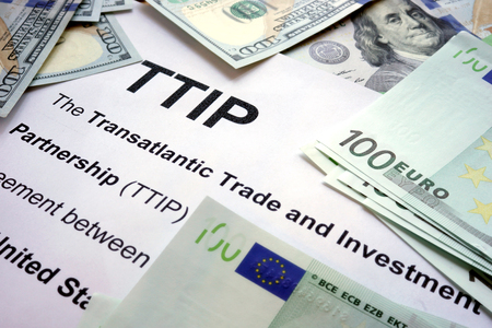 lobbyists: Word TTIP on a paper with dollars and euros. Stock Photo