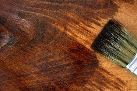 home decorating: Staining wooden surface. Home decorating concept. DIY