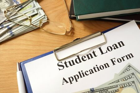 university application: Student loan form with dollars and books. Stock Photo