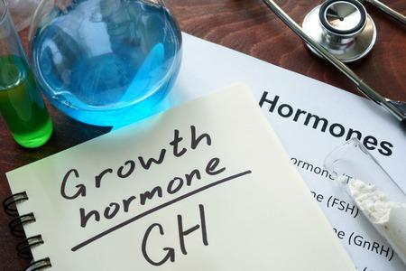 hormone: growth hormone written on notebook. Stock Photo