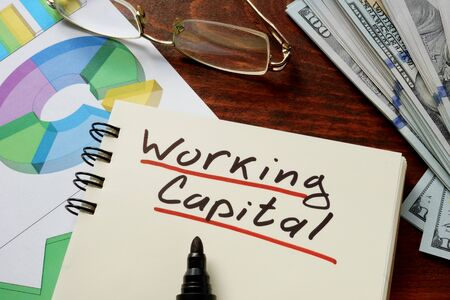 cash cycle: Working Capital written on notebook with charts.