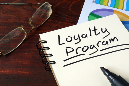 loyalty: Loyalty Program written on notebook with charts. Stock Photo