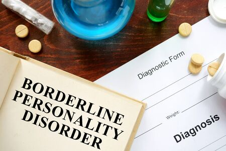 borderline: Borderline personality disorder written on book with tablets.