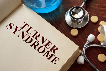 turner: Turner syndrome written on book with tablets.