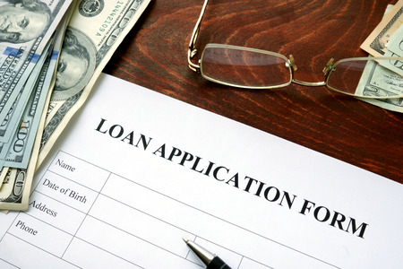 mortgage application: Loan application form on a wooden table.