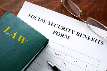 benefits: Social security benefits form on a wooden table.