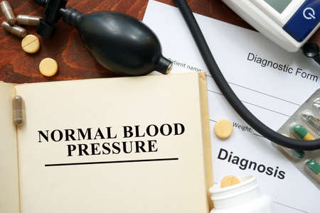 pressure: Normal blood pressure written on a book. Medical concept. Stock Photo