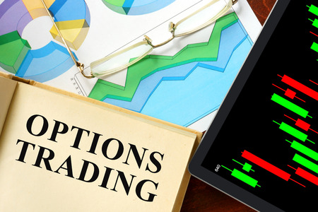 trade: Words options trading written on a book. Business concept. Stock Photo