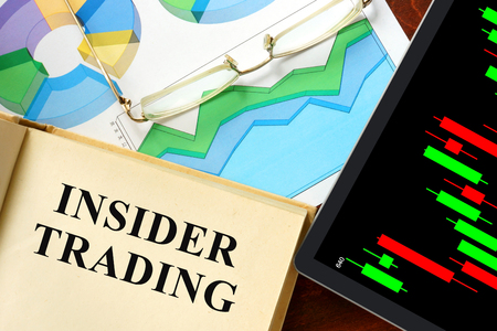 insider trading: Words insider trading written on a book. Business concept.