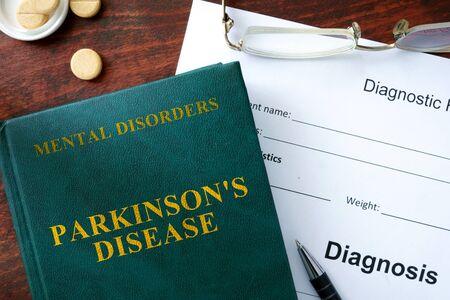 parkinson's: Parkinsons disease  concept. Diagnostic form and book on a table.