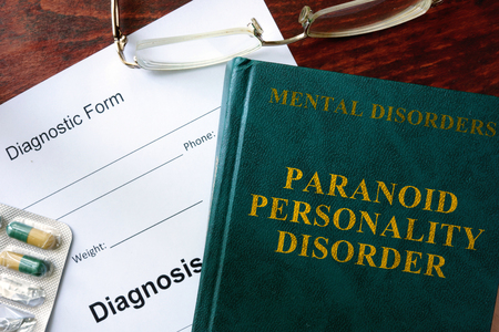 paranoid: Paranoid personality disorder  concept. Diagnostic form and book on a table.