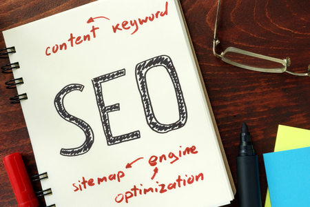 seo: Words SEO search engine optimization written in the notepad.
