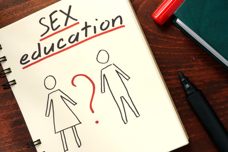 Words sex education written in the notepad. 스톡 콘텐츠