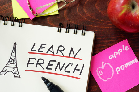 french: Words learn french written in the notepad.