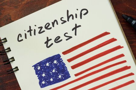citizenship: Notepad with words  citizenship test and American flag.