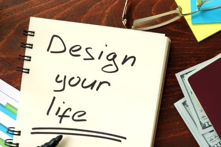 personality development: Words Design your life written in the notepad.