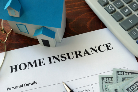 Home insurance   form and dollars on the table. Banque d'images