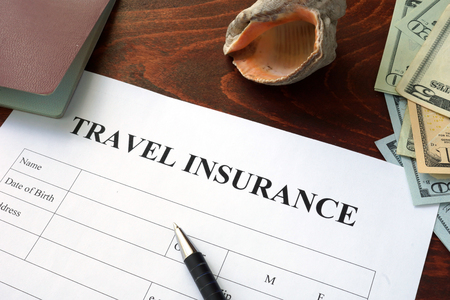 overseas: Travel insurance  form and dollars on the table.